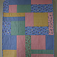 Project Linus scrapy crib quilt